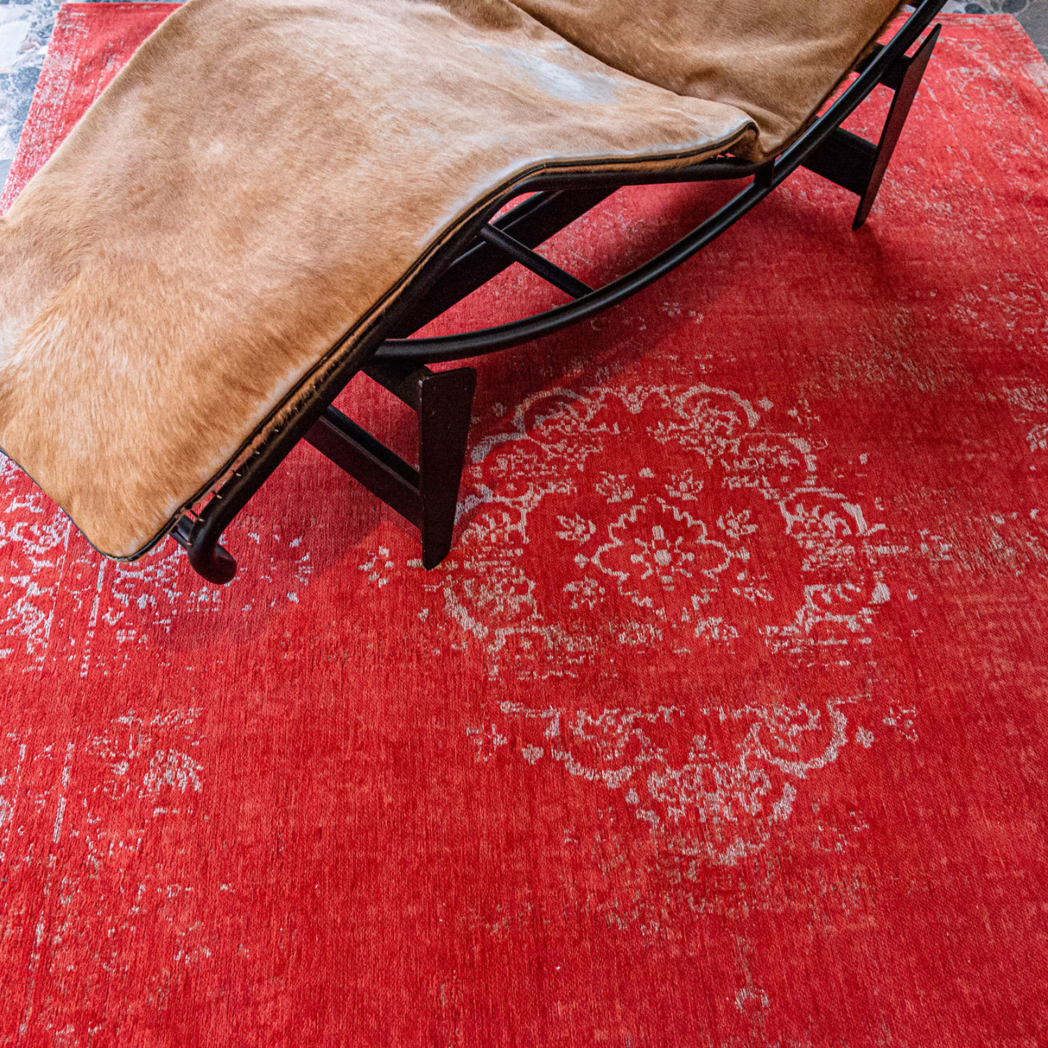The central pattern or medallion of this rug is an ancient classic.