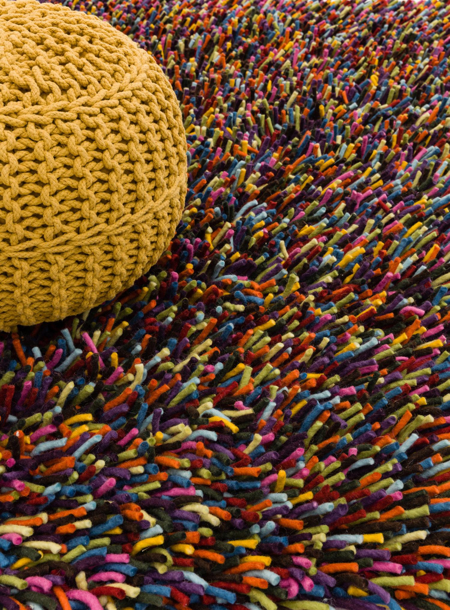 Bold multi colour shaggy felted wool rug.
