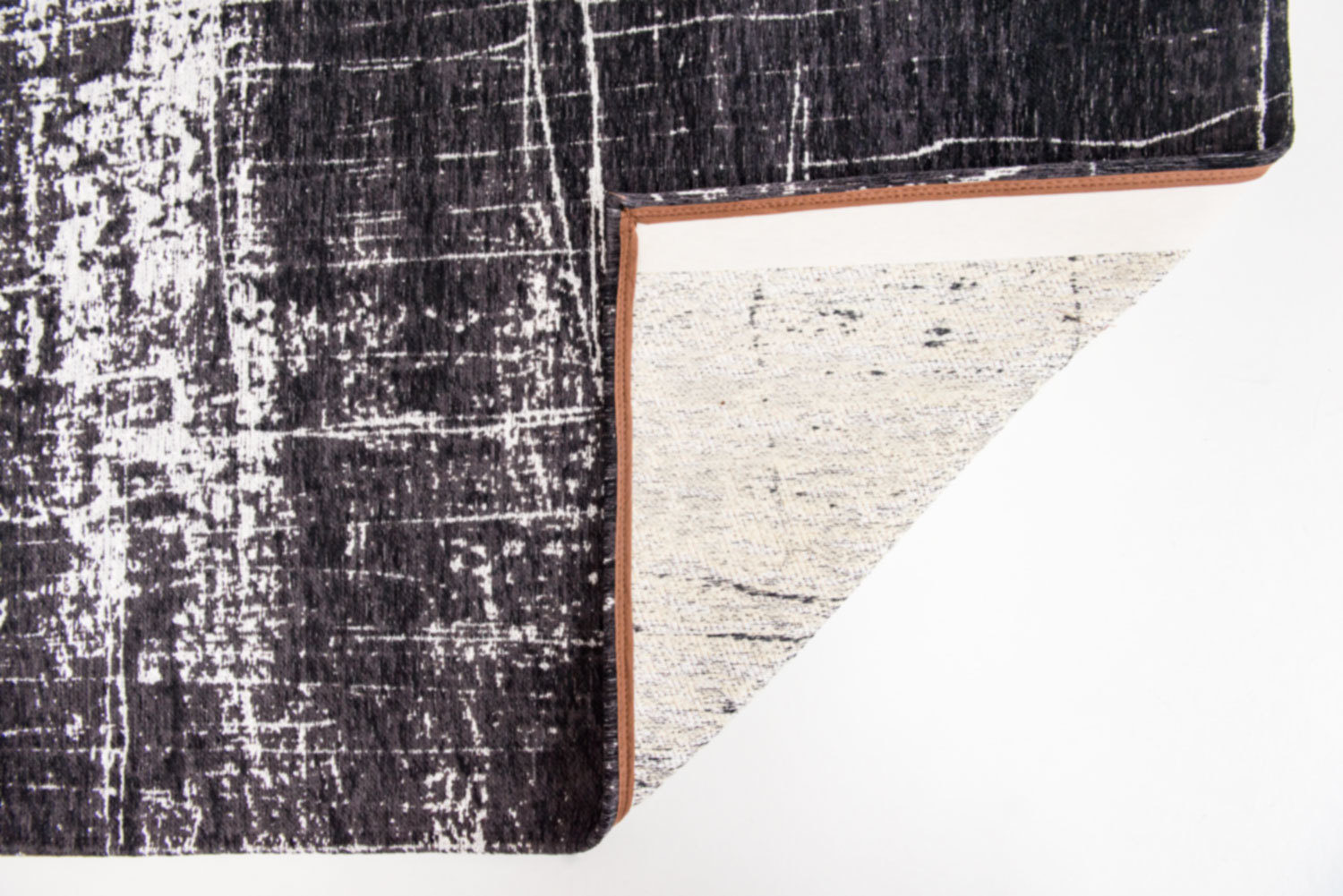 A mix of straight and broken lines, of dull and shining yarns, of smooth and ragged pencil strokes.