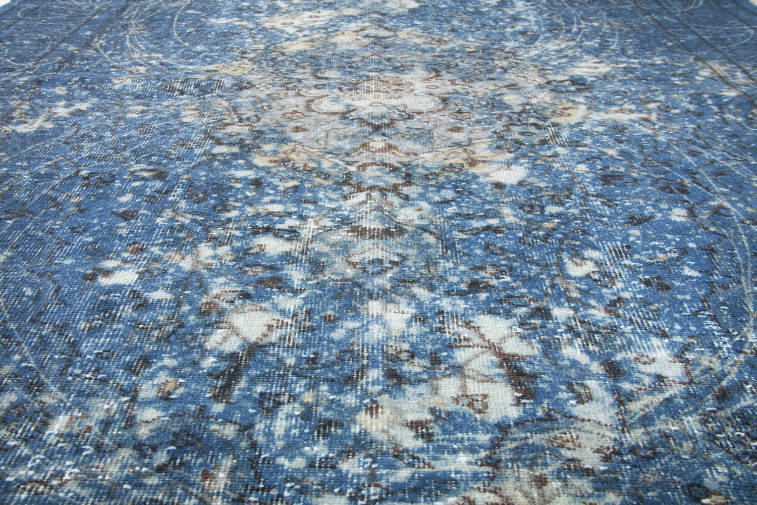 Vintage rug overdyed to create modern abstract patterns