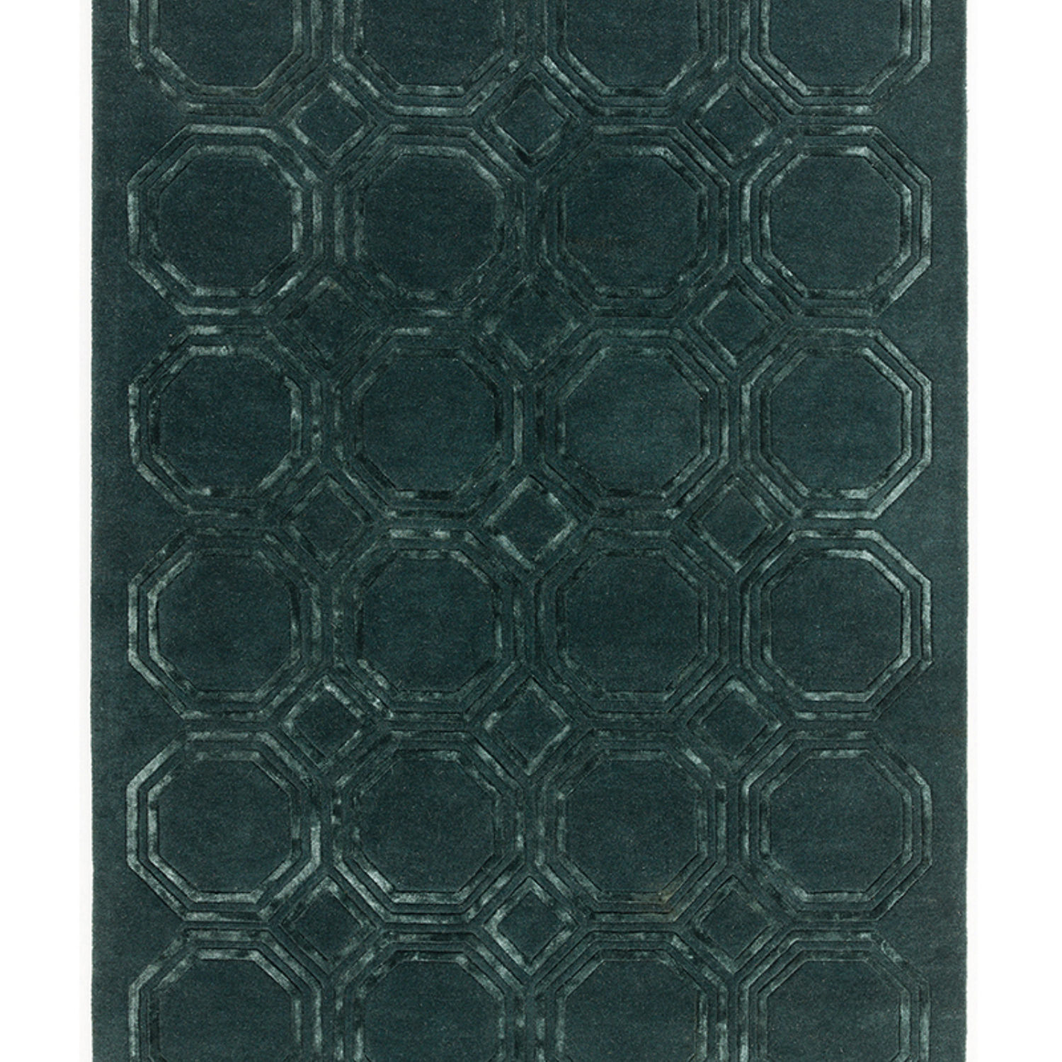 Prenium quality hand tufted rug in precise hand carved geometric designs