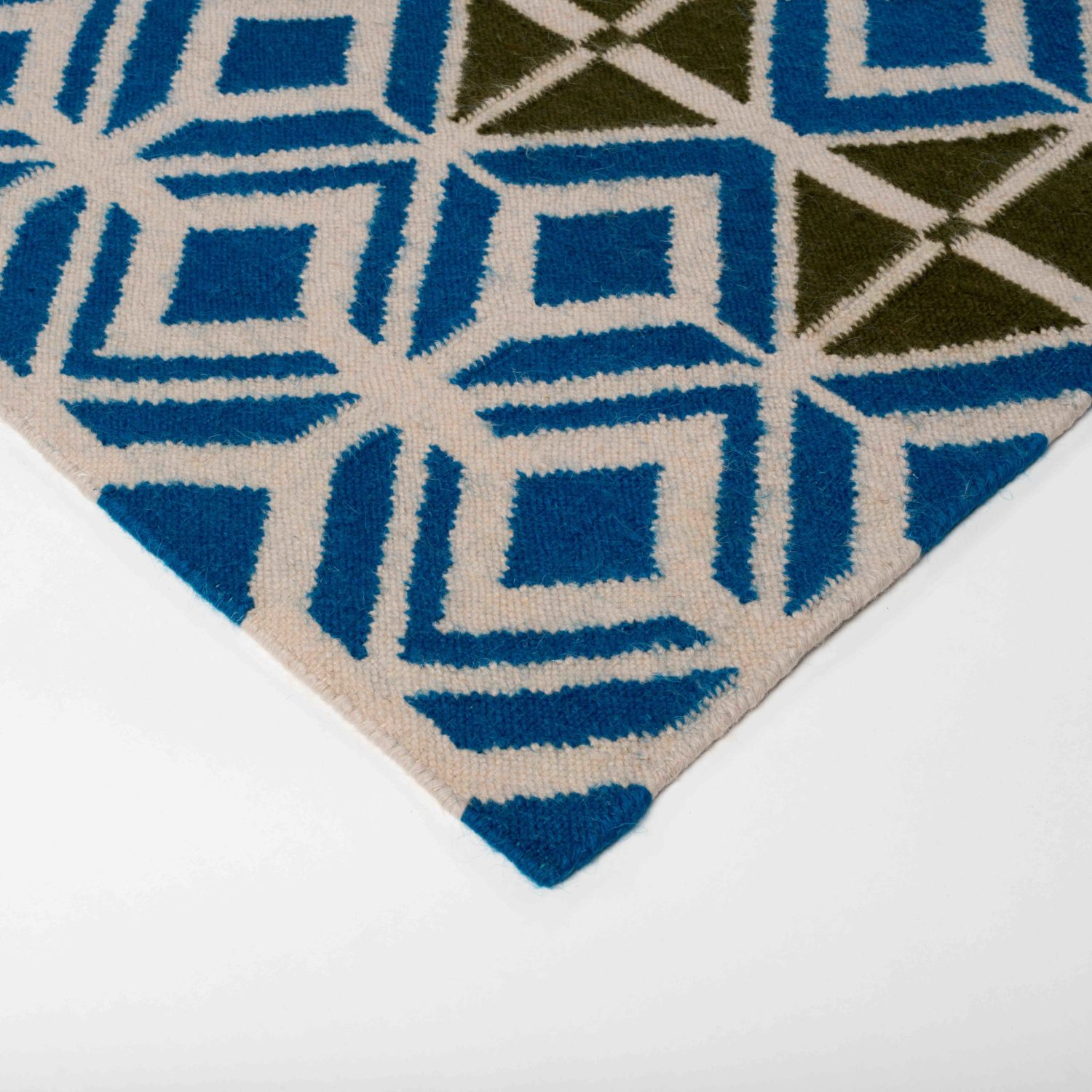 A rug drawing influence from the industrial revolution and the fusion between industry and craft