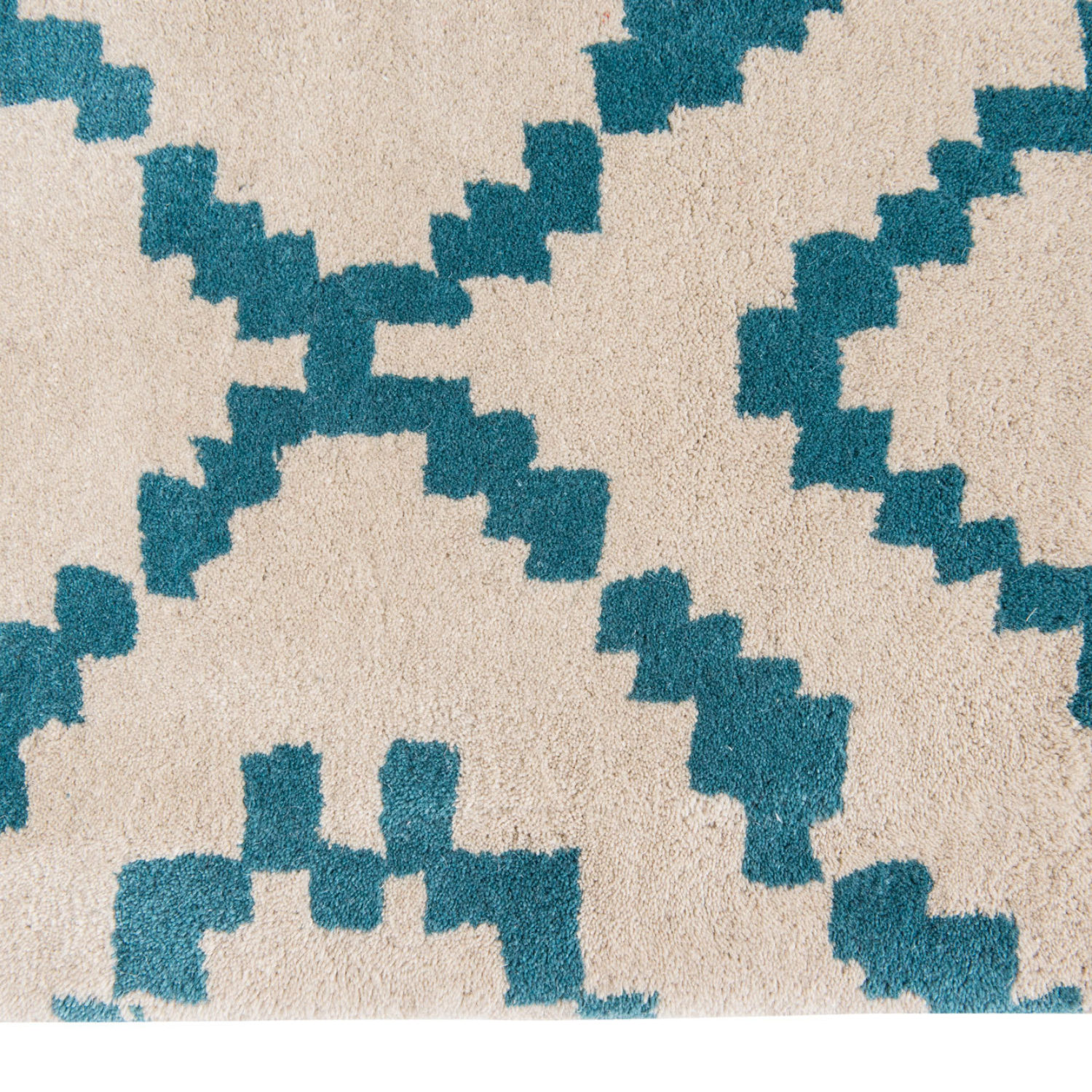 Sami is a striking, folk art inspired, geometric design beautifully recreated as a luxurious hand tufted wool rug.