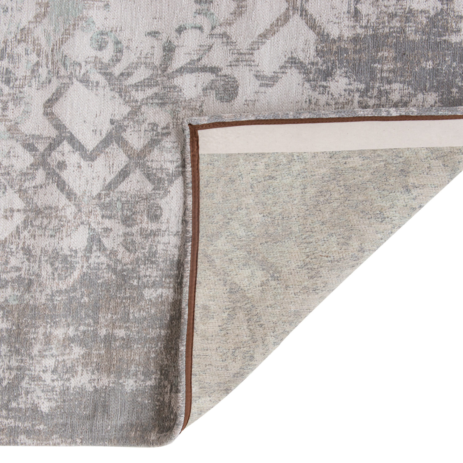 Multi-layered composition of floral, Arabic geometric and distressed elements, set in soft hues
