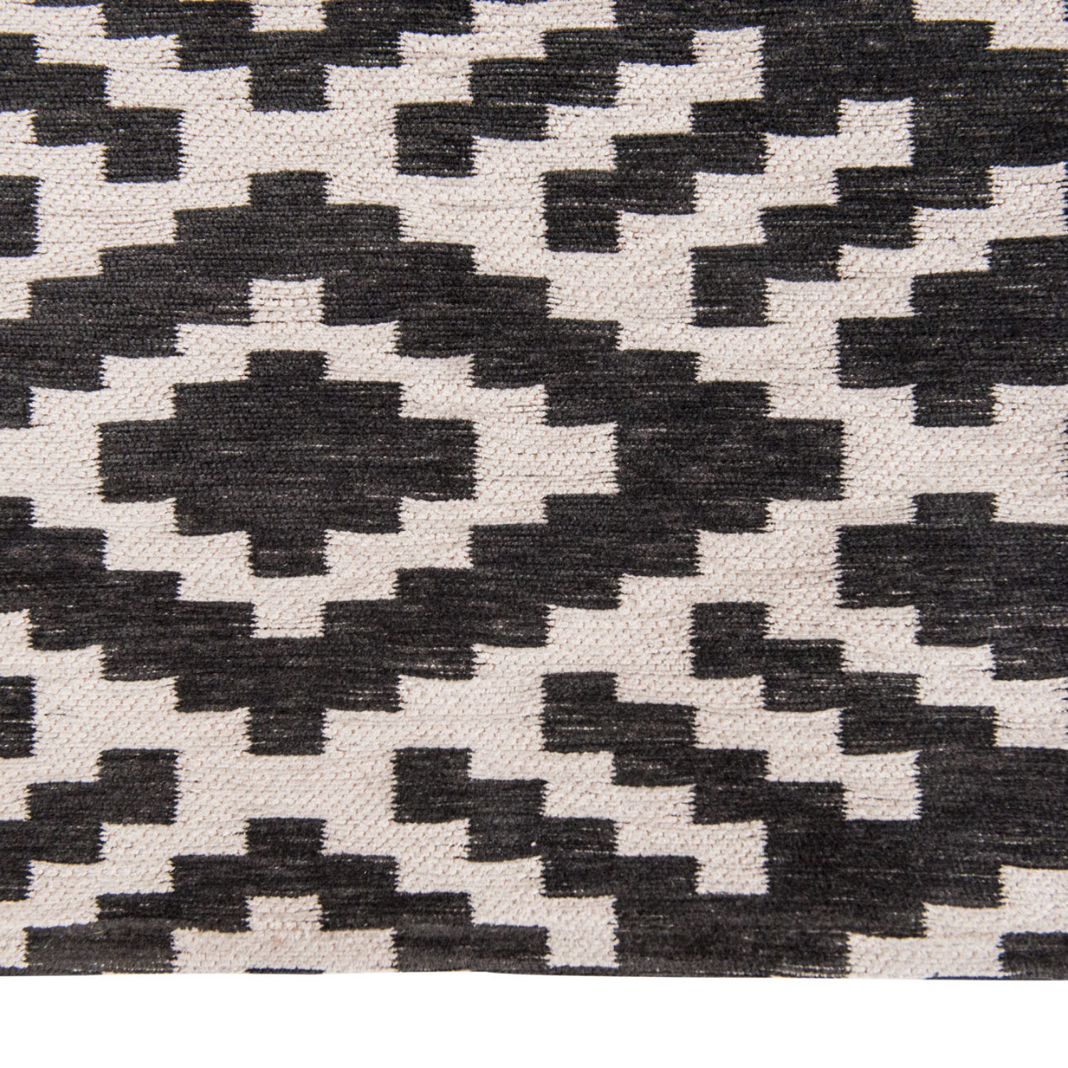 A striking geometric, reminiscent of a traditional tribal design woven with exquisitely soft chenille.