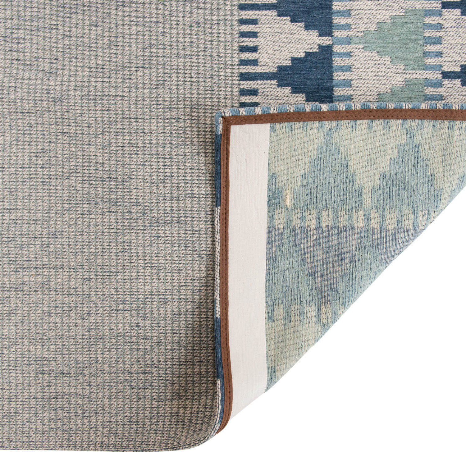 A characterful flat weave rug combining cotton chenille and wool yarns