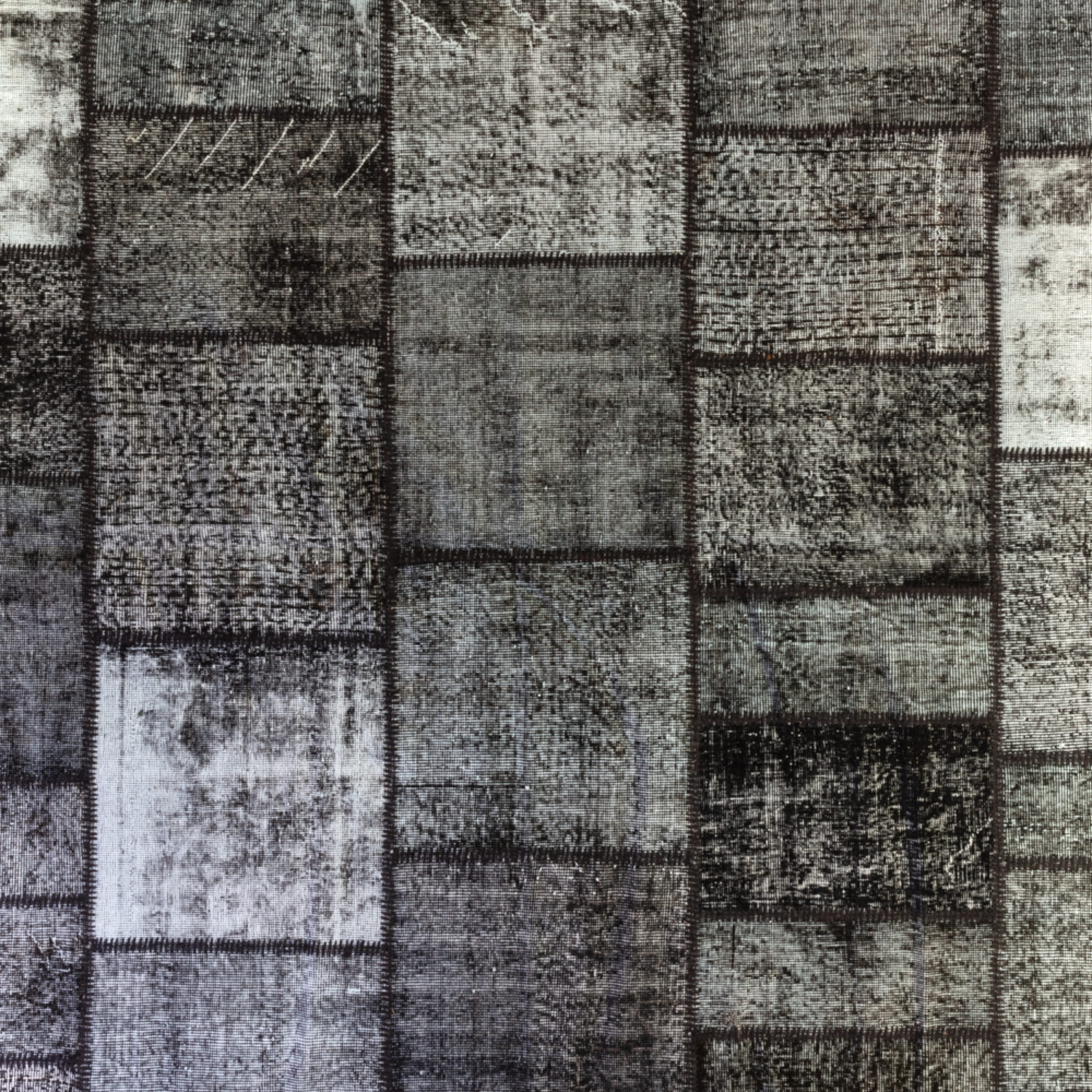 A patchwork of repurposed vintage rugs