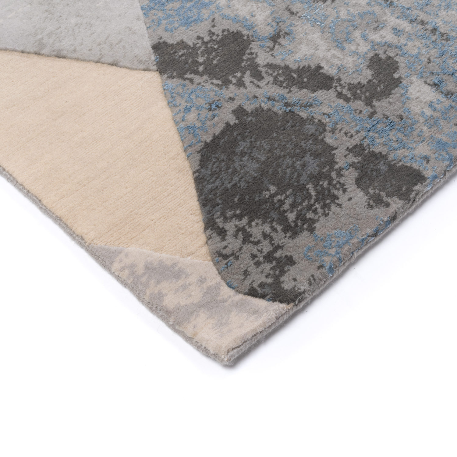 Storm clouds broken by diamonds set this modern rug apart
