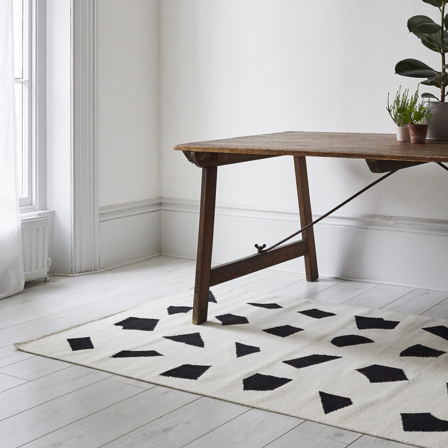 Unusual shapes and high-contrast define this modern kilim