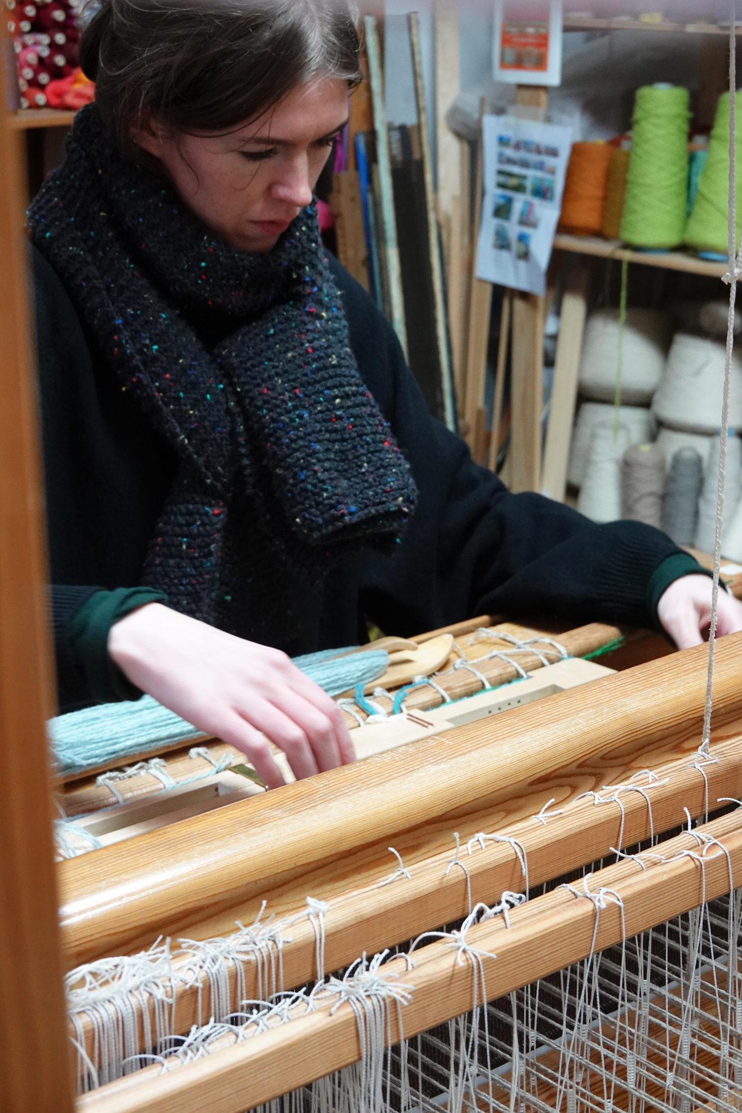 Gill working on the floor loom.